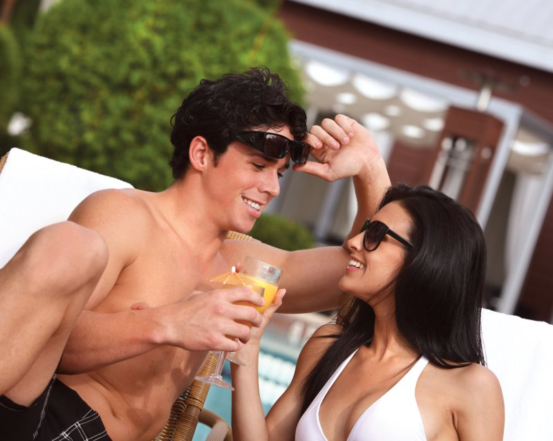 A male and female couple enjoying a beverage at the Cabana Bar and Beack Club at the Walt Disney World Dolphin Resort