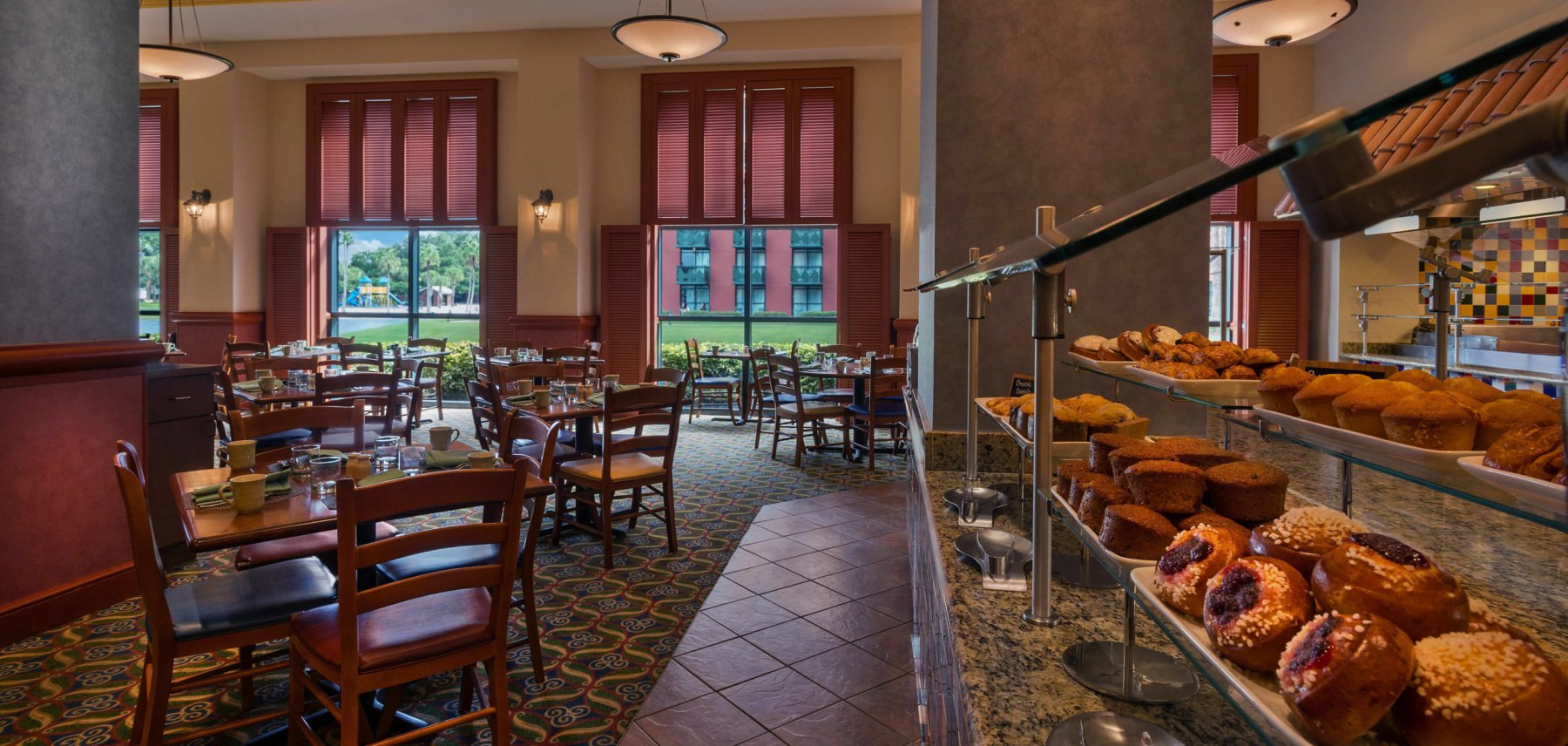 A look at the main seating area with a close up of the buffet featuring pastries at Fresh at the Walt Disney World Dolphin Resort