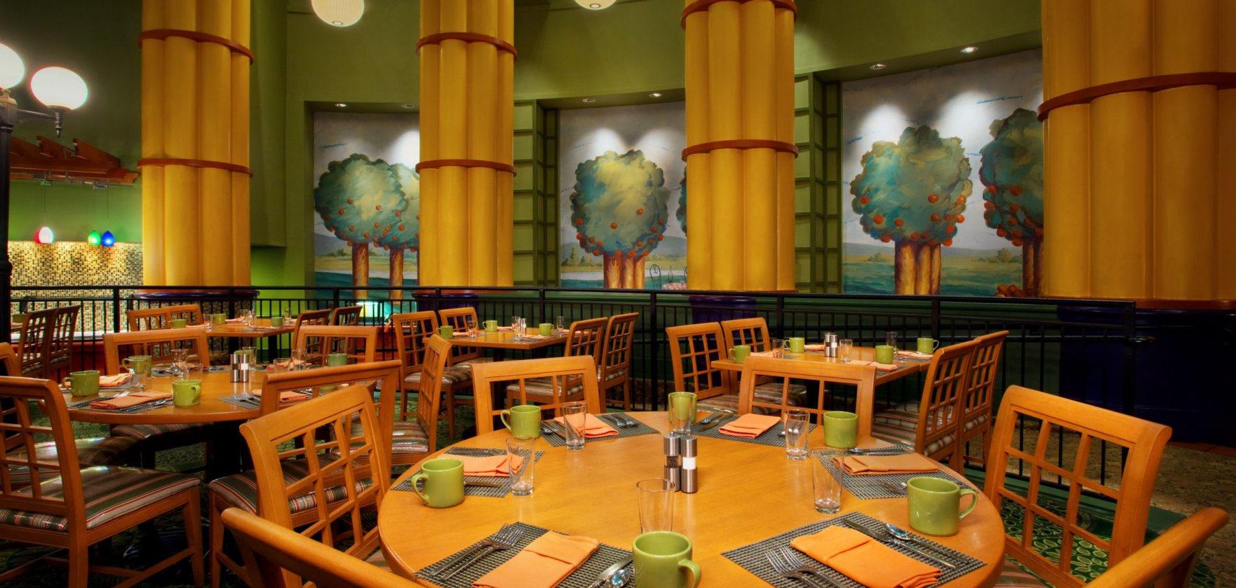 An interior view of the seating area in the Garden Grove restaurant at the Walt Disney World Swan Resort