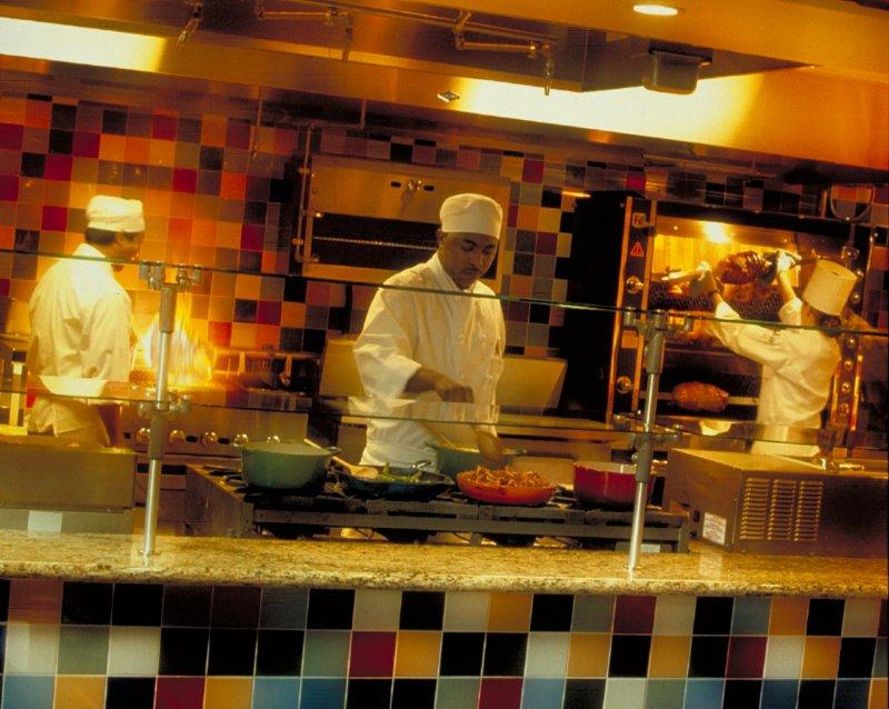 Chefs cooking at Fresh Mediterranean Market